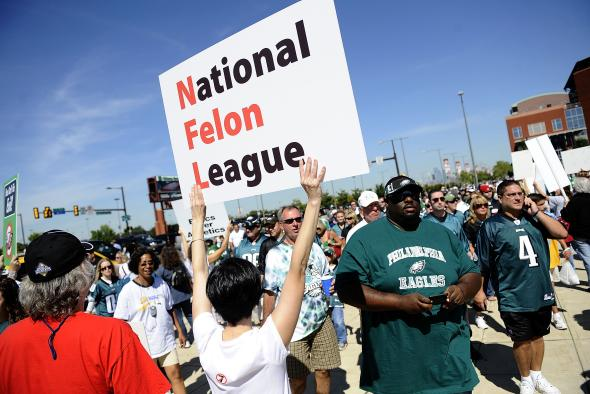 90982382-football-fans-stream-past-people-protesting-the-nfl-re.jpg.CROP.promovar-mediumlarge